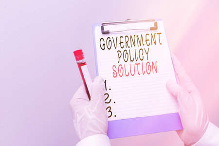 Handwriting text Government Policy Solution. Conceptual photo designed game plan created in response to emergency disaster Laboratory blood test sample shown for medical diagnostic analysis result