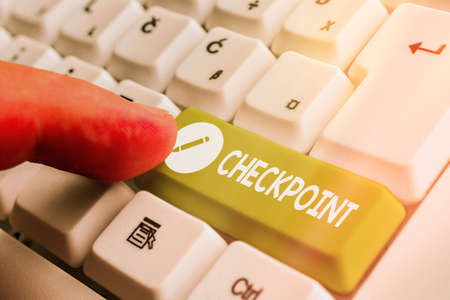 Word writing text Checkpoint. Business photo showcasing manned entrance, where travelers are subject to security checks White pc keyboard with empty note paper above white key copy space