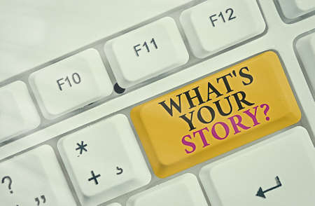 Handwriting text What S Your Story Question. Conceptual photo Share or tell us your life experiences and success Different colored keyboard key with accessories arranged on empty copy space Stock Photo