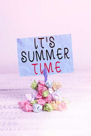 Conceptual hand writing showing It S Summer Time. Concept meaning season for fun and excitement enjoying the sunny weather Reminder pile colored crumpled paper clothespin wooden space Stock fotó