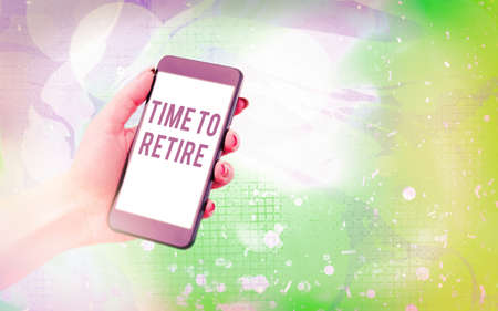 Word writing text Time To Retire. Business photo showcasing bank savings account, insurance, and pension planning Modern gadgets with white display screen under colorful bokeh background Banque d'images