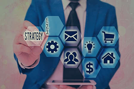 Conceptual hand writing showing Strategy. Concept meaning action plan or strategy designed to achieve an overall goal Grids and different icons latest digital technology concept Stock Photo