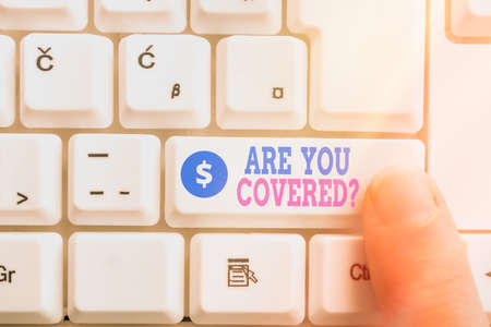 Writing note showing Are You Covered Question. Business concept for asking if they had insurance in work or life Pc keyboard key with pointing finger above background copy space
