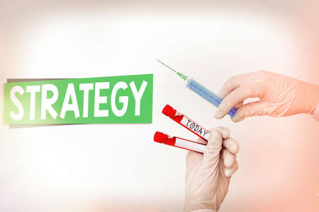 Word writing text Strategy. Business photo showcasing action plan or strategy designed to achieve an overall goal Extracted blood sample vial ready for medical diagnostic examination Stock Photo
