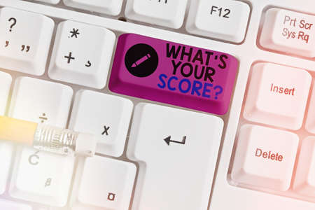 Conceptual hand writing showing What S Your Score Question. Concept meaning Tell Personal Individual Rating Average Results Statistics Colored keyboard key with accessories arranged on copy space