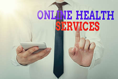 Conceptual hand writing showing Online Health Services. Concept meaning healthcare delivered and enhanced through the internet Model pointing finger symbolizing navigation progress growth