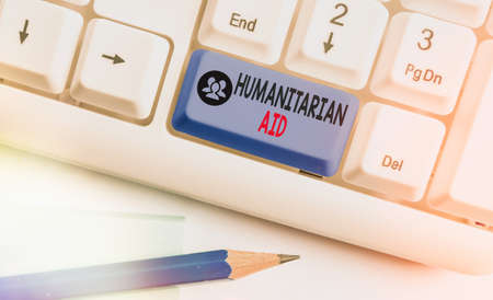 Word writing text Humanitarian Aid. Business photo showcasing immediate assistance provided after natural and manmade disaster White pc keyboard with empty note paper above white key copy space