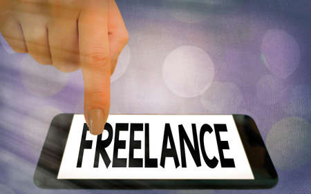 Writing note showing Freelance. Business concept for working at different firms rather than being permanently Modern gadgets white screen under colorful bokeh background Reklamní fotografie