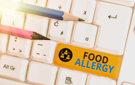 Conceptual hand writing showing Food Allergy. Concept meaning abnormal immune system response to allergen after eaten Colored keyboard key with accessories arranged on empty copy space