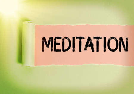 Text sign showing Meditation. Business photo showcasing achieve a mentally clear and emotionally calm and stable state Rolled ripped torn cardboard placed above a wooden classic table backdrop Stockfoto