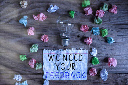 Writing note showing We Need Your Feedback. Business concept for Give us your ideas and suggestions on what to improve Realistic colored vintage light bulbs, idea sign solution Foto de archivo