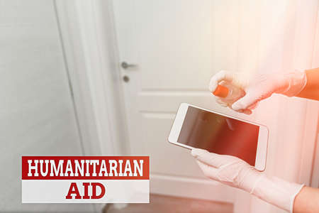 Word writing text Humanitarian Aid. Business photo showcasing immediate assistance provided after natural and manmade disaster Contamination within electronic gadgets sufaces controlled by disinfectant