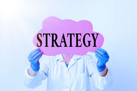 Text sign showing Strategy. Business photo text action plan or strategy designed to achieve an overall goal Laboratory technician featuring empty sticker paper accessories smartphone