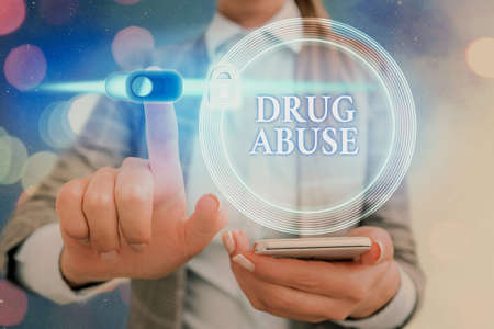 Word writing text Drug Abuse. Business photo showcasing the habitual taking of use of prescription or illegal drugs Graphics padlock for web data information security application system
