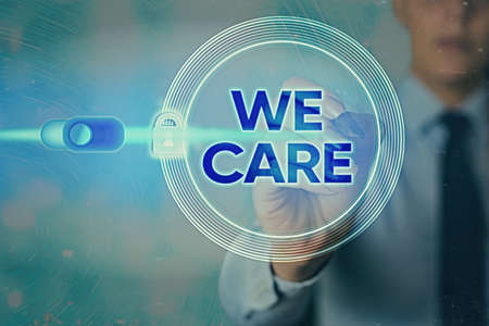 Writing note showing We Care. Business concept for Cherishing someones life Giving care and providing their needs Graphics padlock for web data information security application system 版權商用圖片