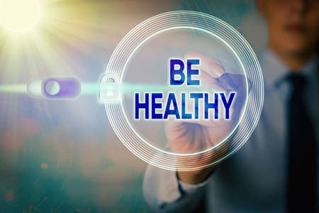 Writing note showing Be Healthy. Business concept for promote a state of complete emotional and physical wellbeing Graphics padlock for web data information security application system