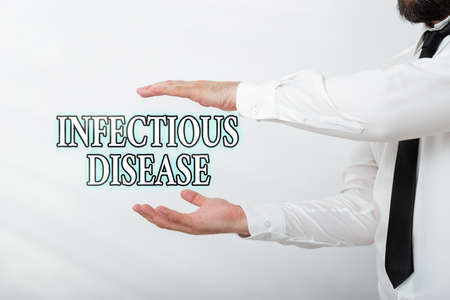 Word writing text Infectious Disease. Business photo showcasing caused by pathogenic microorganism, such as viruses, etc Model with pointing hand finger symbolizing navigation progress growth Stock Photo