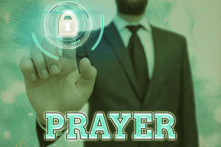 Conceptual hand writing showing Prayer. Concept meaning solemn request for help or expression of thanks addressed to God Graphics padlock for web data security application system Фото со стока
