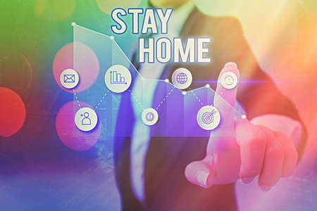 Text sign showing Stay Home. Business photo showcasing not go out for an activity and stay inside the house or home Arrow symbol going upward denoting points showing significant achievement Reklamní fotografie