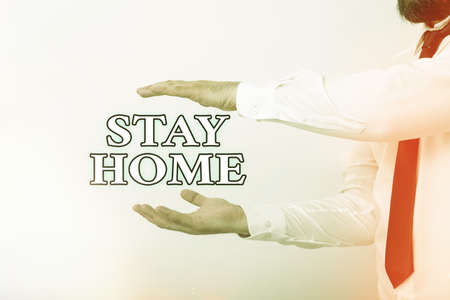 Word writing text Stay Home. Business photo showcasing not go out for an activity and stay inside the house or home Model with pointing hand finger symbolizing navigation progress growth