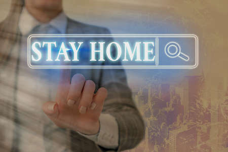 Writing note showing Stay Home. Business concept for not go out for an activity and stay inside the house or home Web search digital information futuristic technology network connection