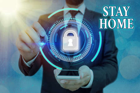 Word writing text Stay Home. Business photo showcasing not go out for an activity and stay inside the house or home Graphics padlock for web data information security application system Reklamní fotografie