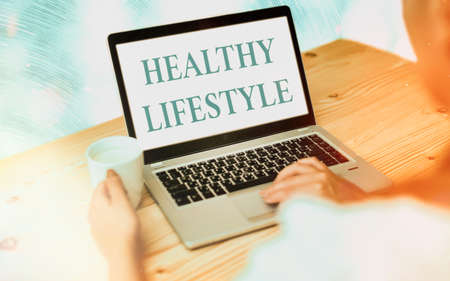 Handwriting text writing Healthy Lifestyle. Conceptual photo way of living that lowers the risk of being seriously ill Modern gadgets with white display screen under colorful bokeh background Фото со стока