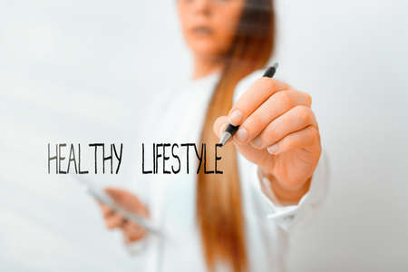 Word writing text Healthy Lifestyle. Business photo showcasing way of living that lowers the risk of being seriously ill Model displaying different shots of holding pen ready for promotional use