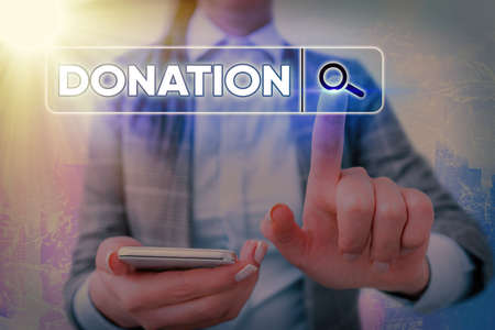 Writing note showing Donation. Business concept for something that is given to a charity, especially a sum of money Web search digital information futuristic technology network connection