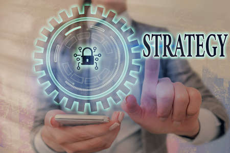 Writing note showing Strategy. Business concept for action plan or strategy designed to achieve an overall goal Graphics padlock for web data information security application system Foto de archivo