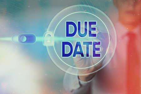 Writing note showing Due Date. Business concept for the day or date by which something is supposed to be done or paid Graphics padlock for web data information security application system Stock Photo
