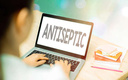 Conceptual hand writing showing Antiseptic. Concept meaning antimicrobial agents that delays or completely eliminate microorganism Modern gadgets white screen under colorful bokeh background
