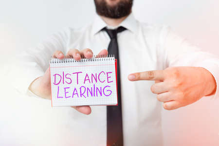 Writing note showing Distance Learning. Business concept for educational lectures broadcasted over the Internet remotely Model displaying different empty color notepad mock-up for writing idea