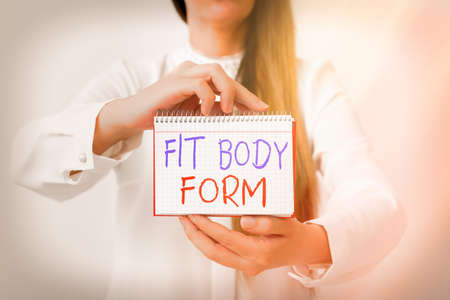 Text sign showing Fit Body Form. Business photo text refers to a body that perfectly aligns of shape and contour Model displaying different empty color notepad mock-up for writing idea Фото со стока