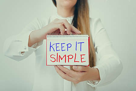 Text sign showing Keep It Simple. Business photo text ask something easy understand not go into too much detail Model displaying different empty color notepad mock-up for writing idea