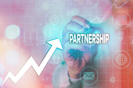 Writing note showing Partnership. Business concept for business type in which two or more individuals share ownership Arrow symbol going upward showing significant achievement