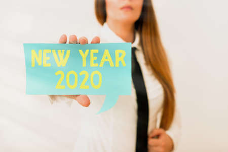 Writing note showing New Year 2020. Business concept for Greeting Celebrating Holiday Fresh Start Best wishes Displaying different color mock up notes for emphasizing content