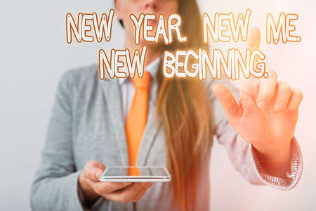 Handwriting text New Year. New Me. New Beginning.. Conceptual photo time for setting new goals for ourselves Model with pointing hand finger symbolizing navigation progress growth Archivio Fotografico