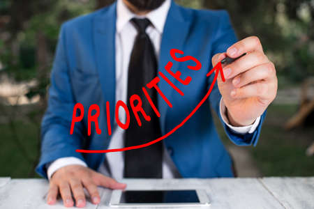 Text sign showing Priorities. Business photo text more important is the fact or state of being viewed or handled digital arrowhead curve rising upward denoting growth development concept