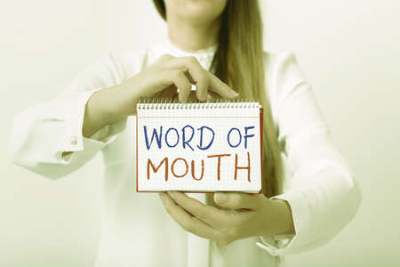 Text sign showing Word Of Mouth. Business photo text information that is transmitted without being written down Model displaying different empty color notepad mock-up for writing idea