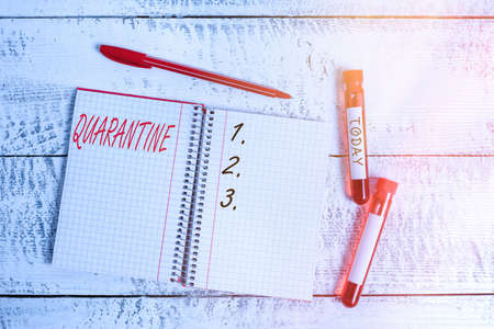 Conceptual hand writing showing Quarantine. Concept meaning restraint upon the activities of an individual or the transport of goods Blood sample vial medical accessories ready for examination
