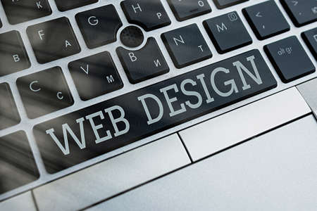 Writing note showing Web Design. Business concept for website creation which includes layout, content, and graphics Pc keyboard key with empty note paper above background copy space