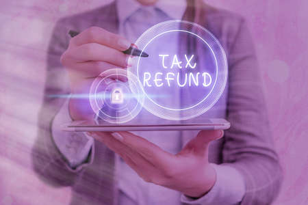 Text sign showing Tax Refund. Business photo showcasing excess payment of paid taxes returned to business owners Graphics padlock for web data information security application system Stock Photo