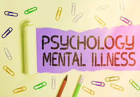 Writing note showing Psychology Mental Illness. Business concept for a behavioral pattern that causes significant distress Rolled ripped torn cardboard above a wooden classic table