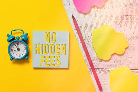 Text sign showing No Hidden Fees. Business photo showcasing without or zero bank charge, service charge, or extras Notepad car sticky notes pen paper sheet alarm clock wooden background Stock fotó - 151692607