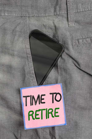 Conceptual hand writing showing Time To Retire. Concept meaning bank savings account, insurance, and pension planning Smartphone device inside trousers front pocket note paper