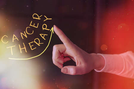 Writing note showing Cancer Therapy. Business concept for the treatment of cancer in a patient often with chemotherapy Digital arrowhead curve denoting growth development concept