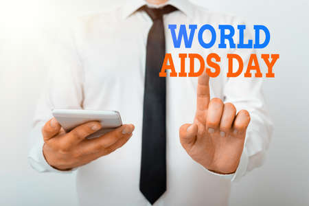 Conceptual hand writing showing World Aids Day. Concept meaning an international day to raised awareness of the AIDS pandemic Model pointing finger symbolizing navigation progress growth Stock Photo
