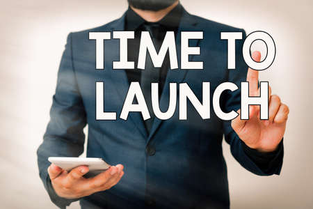 Conceptual hand writing showing Time To Launch. Concept meaning Business StartUp, planning and strategy, management, realization Model pointing finger symbolizing navigation progress growth