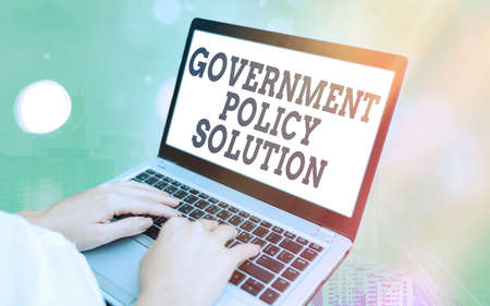 Word writing text Government Policy Solution. Business photo showcasing designed game plan created in response to emergency disaster Modern gadgets with white display screen under colorful bokeh background